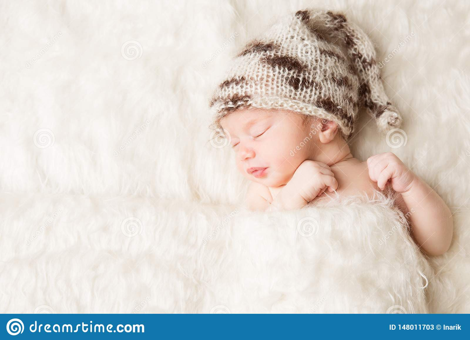 Newborn, baby sleeping in white bed, beautiful new born infant portrait