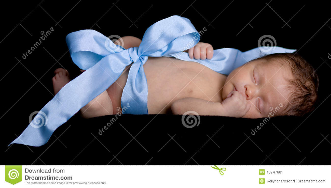 Newborn Baby Wrapped up in Ribbon and Bow Sleeping