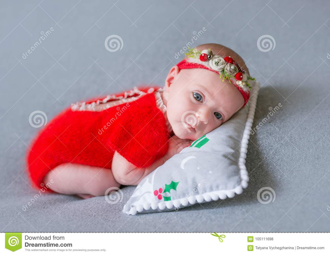 2aaf0ba27 Newborn Girl In A Christmas Suit Is Sleeping On A New Year`s Pillow ...