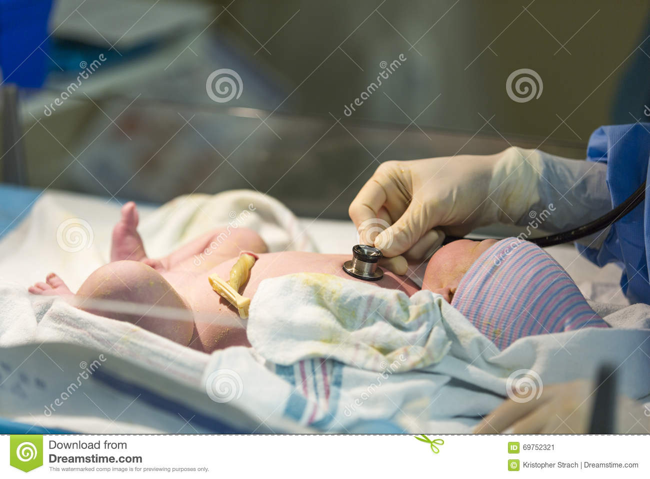 Baby bed heartbeat - Newborn Male Baby Being Checked With Stethoscope
