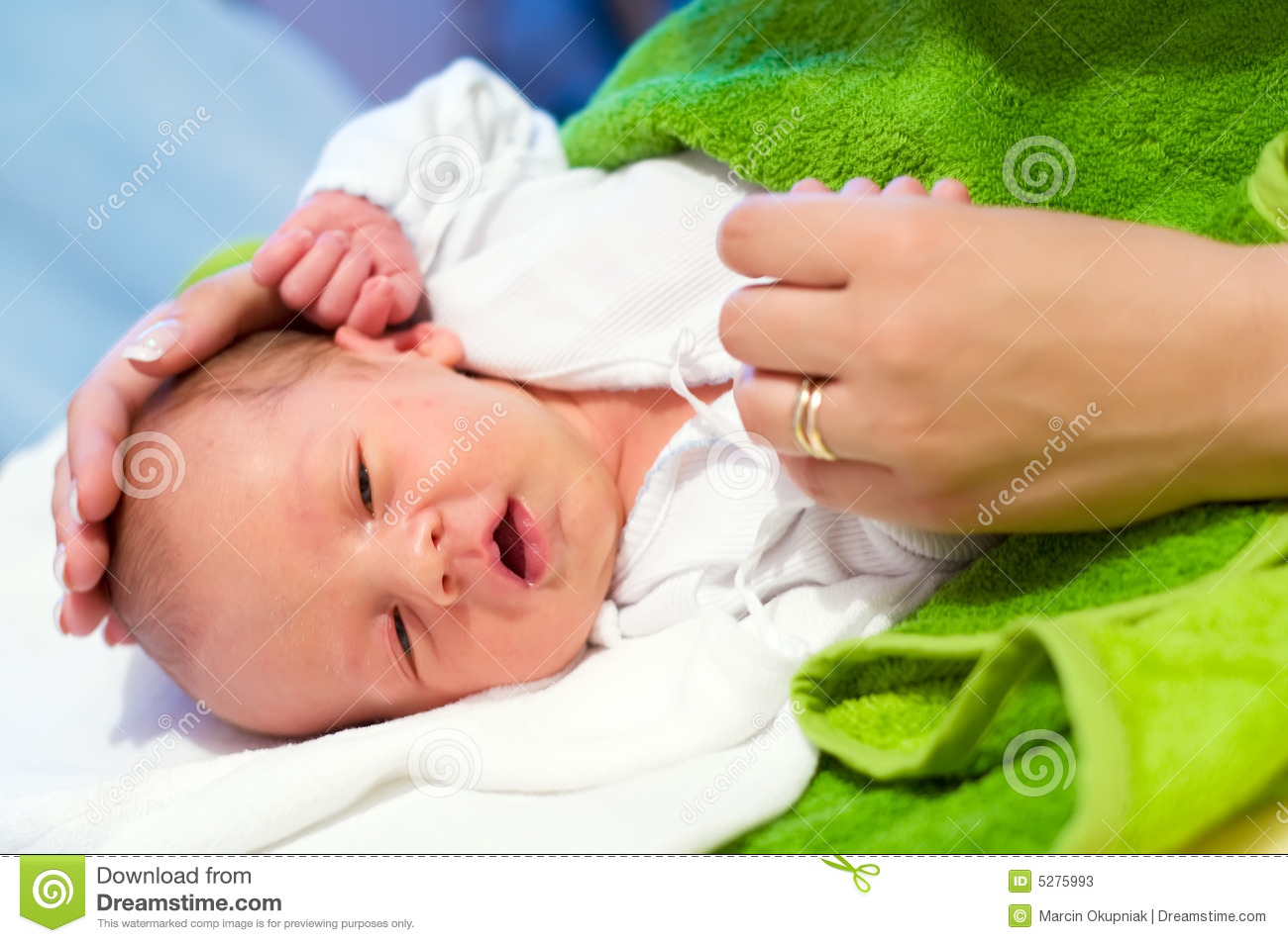 Newborn and mother s hands