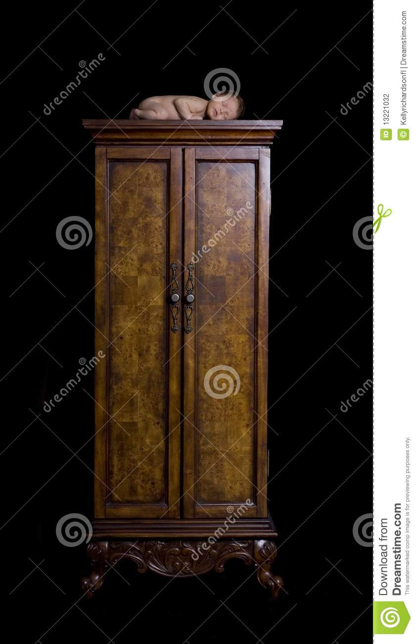 Newborn Sleeping Peacefully On Armoire Dressing Cl Stock Photography Image 13221032
