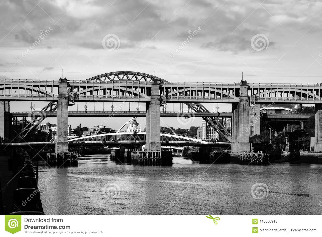 The high level bridge in newcastle upon tyne uk over river tyne during daytime with the tyne bridge behind it cloudy sky black and white