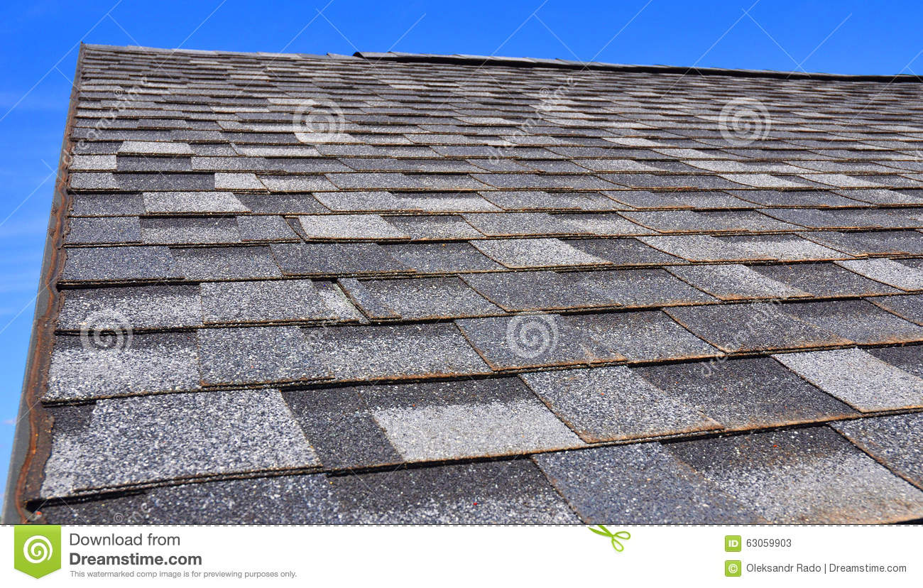 Newly installed roof with textured asphalt shingles or for Roofing tar on shingles