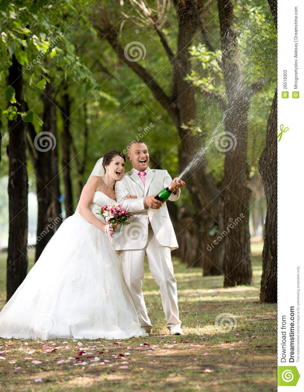 Newly married couple very happiness and fun open champagne outdoor