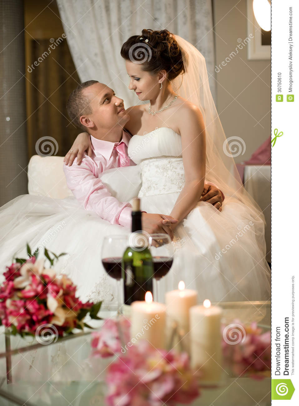Newly married couple in hotel room romance wedding dinner