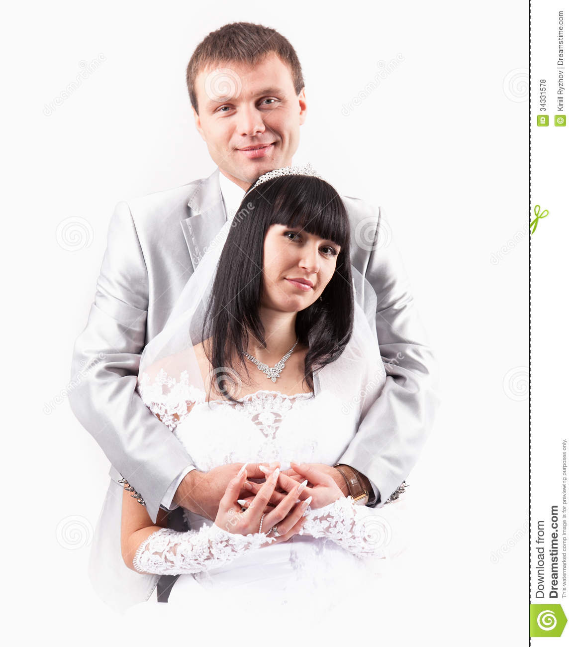 Newly Married Couple Hugging In Studio Stock Photo