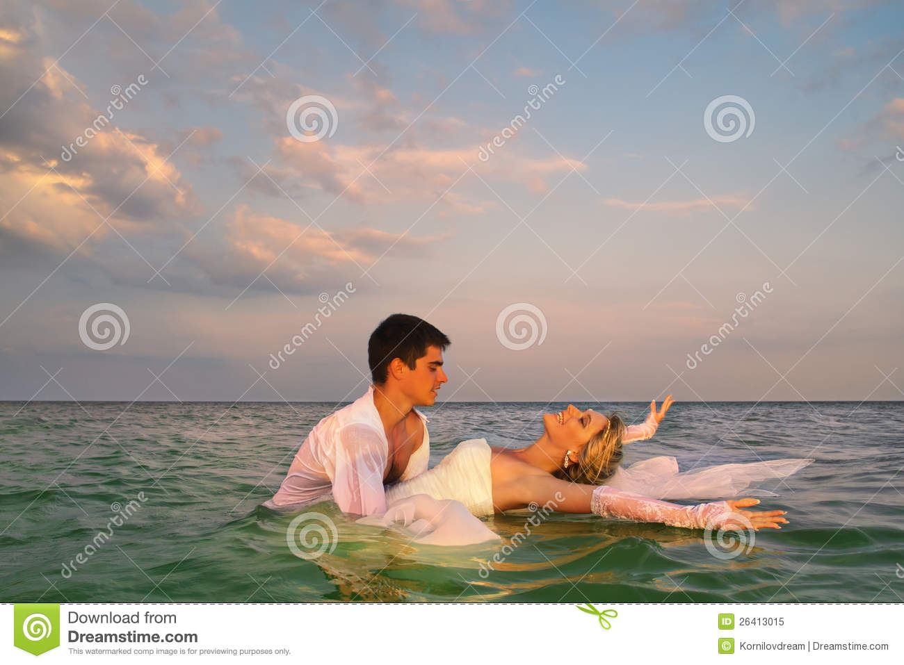 Newly married couple swimming in sea stock photo image of male newly married couple swimming in sea royalty free stock photo kristyandbryce Image collections