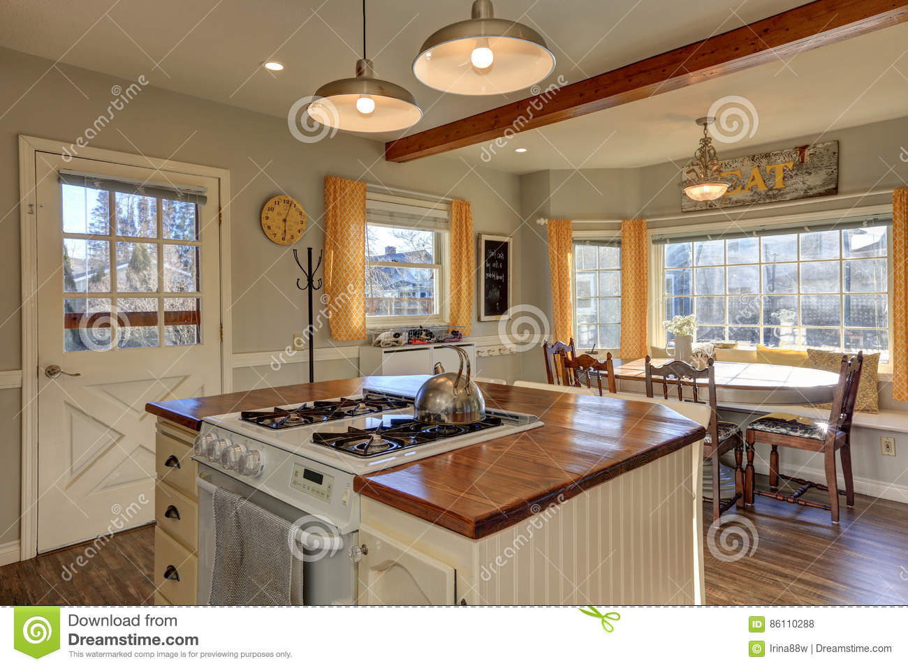 Newly renovated kitchen and breakfast nook with wood beams - Boutons et poignees meubles cuisine ...