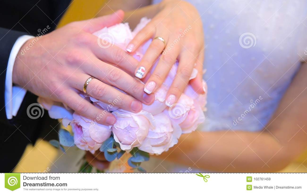 Newly Wed Couple`s Hands With Wedding Rings. Bride And Groom With ...