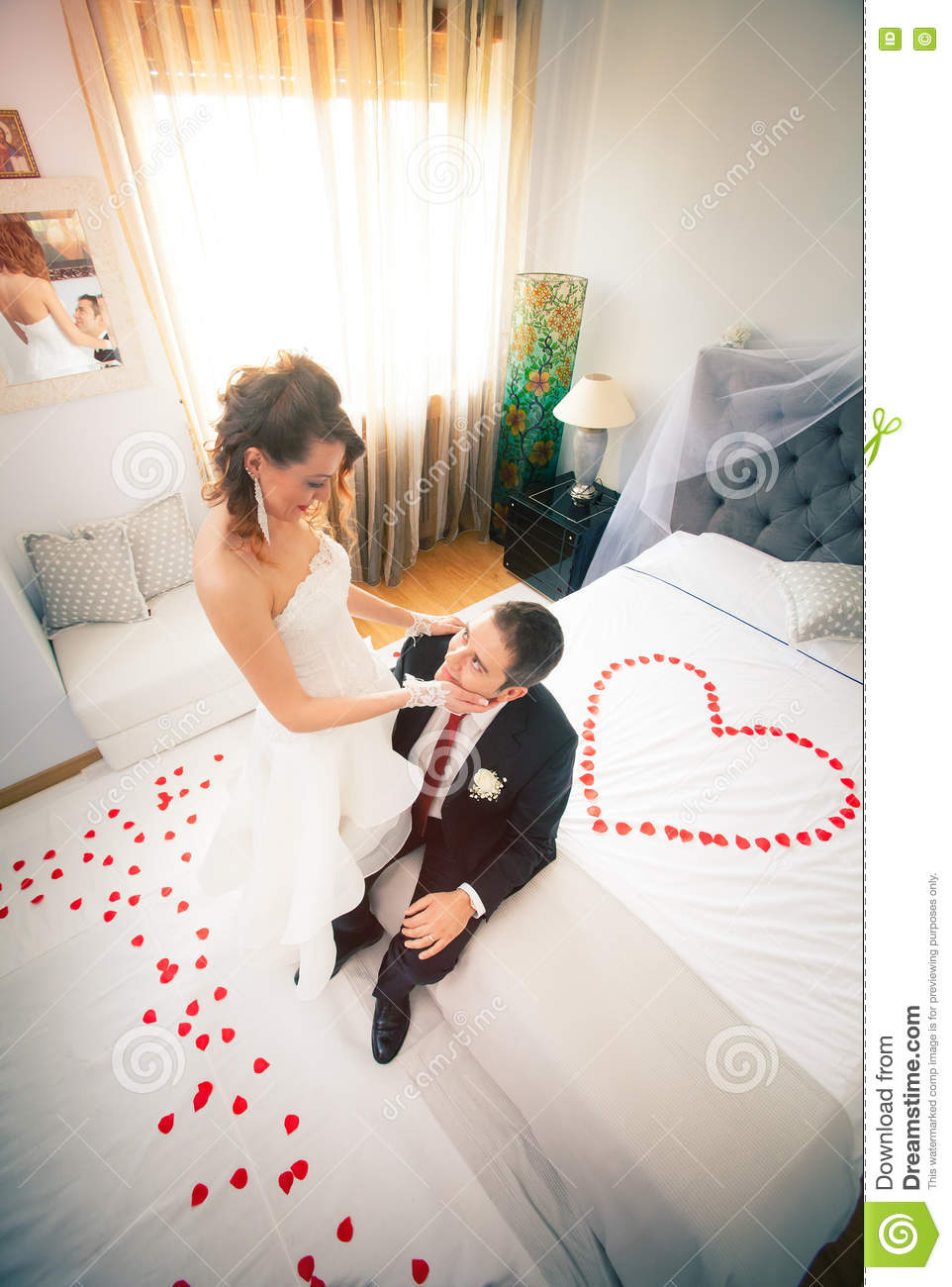 Newlyweds in bedroom with heart stock image image of for Love bedroom photo