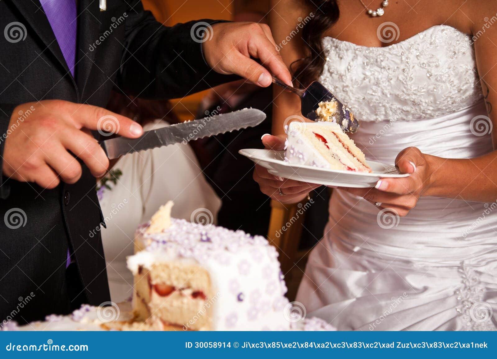 Cutting The Wedding Cake Stock Images