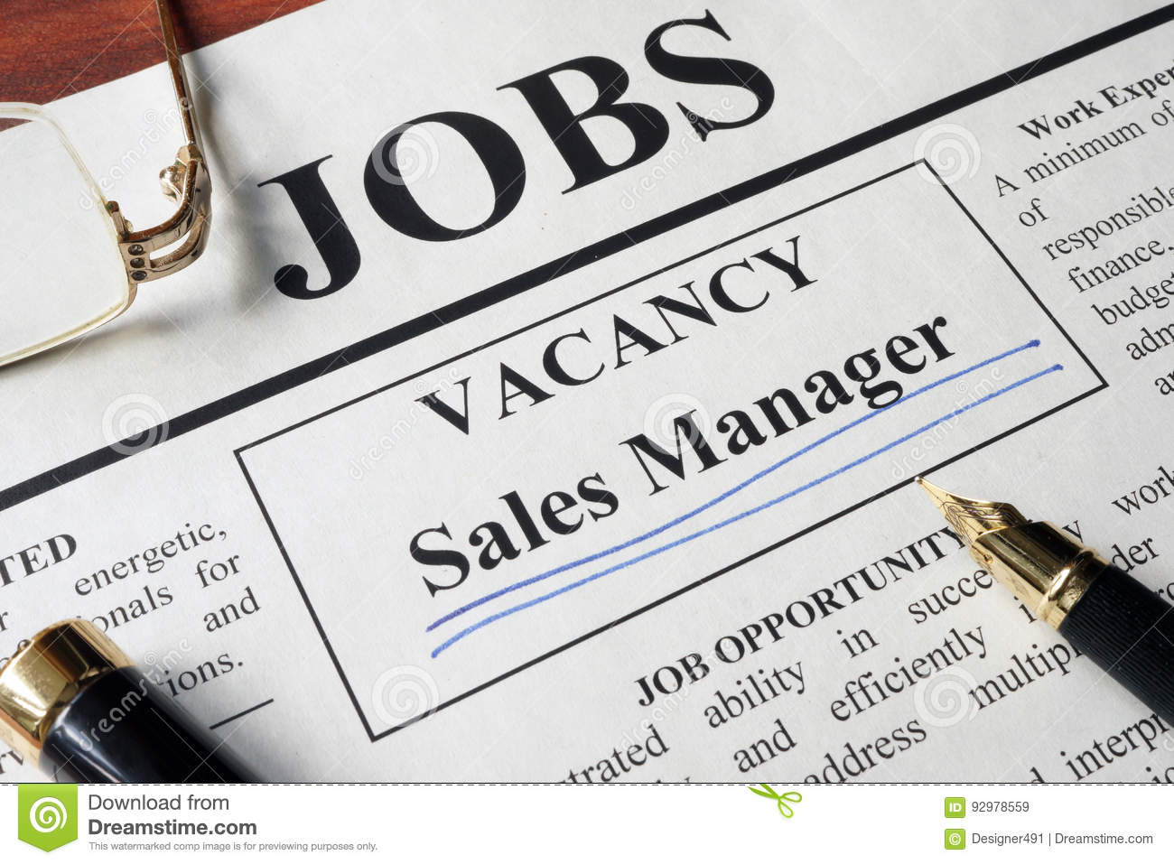 Newspaper with ads for vacancy sales manager.