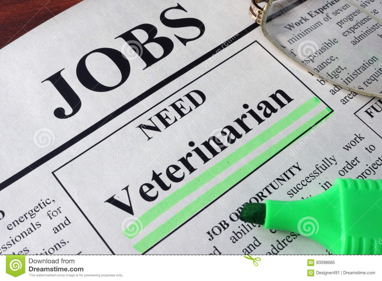 Newspaper with ads for vacancy Veterinarian.