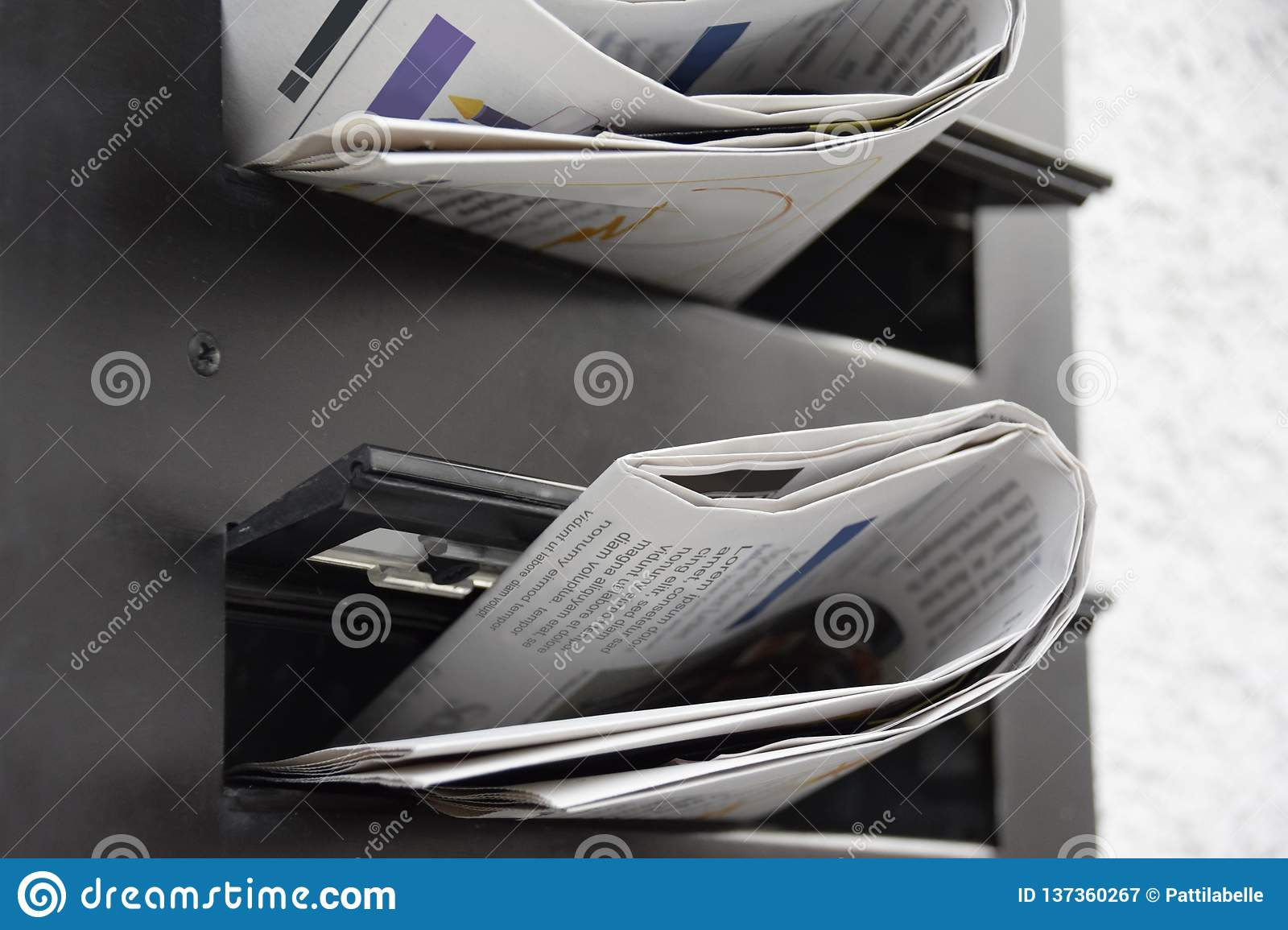 Newspapers in a mailbox stock image  Image of postbox