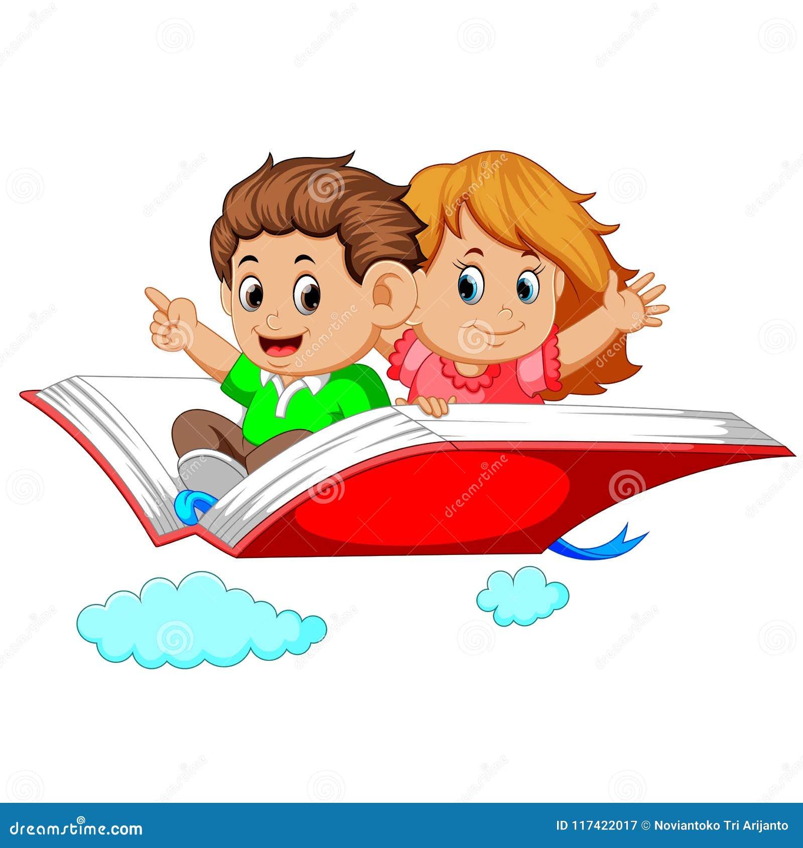 Niños felices que vuelan en el libro abierto grande