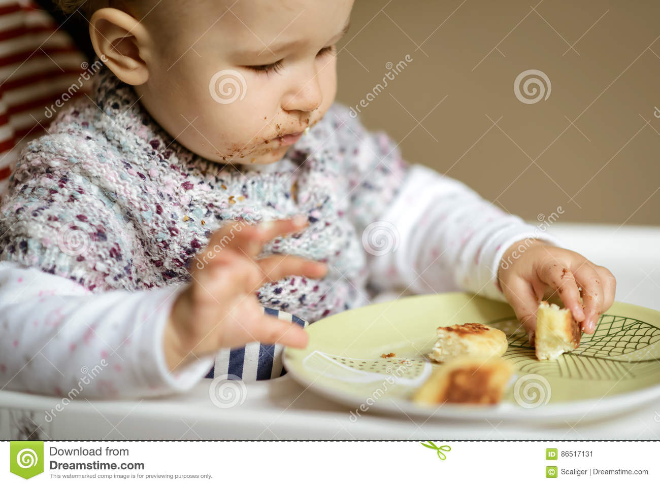 The Nice Baby With Messy Face Eating Cheese Cakes Stock ...