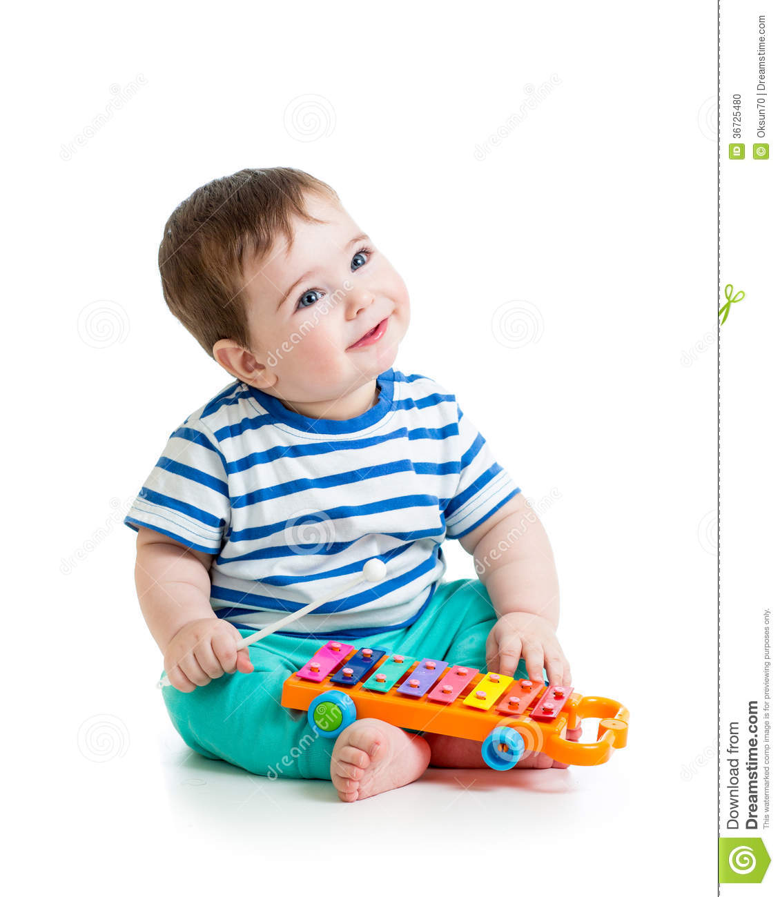 Musical Toys For Toddlers Boys : Nice baby playing with musical toys stock photo image