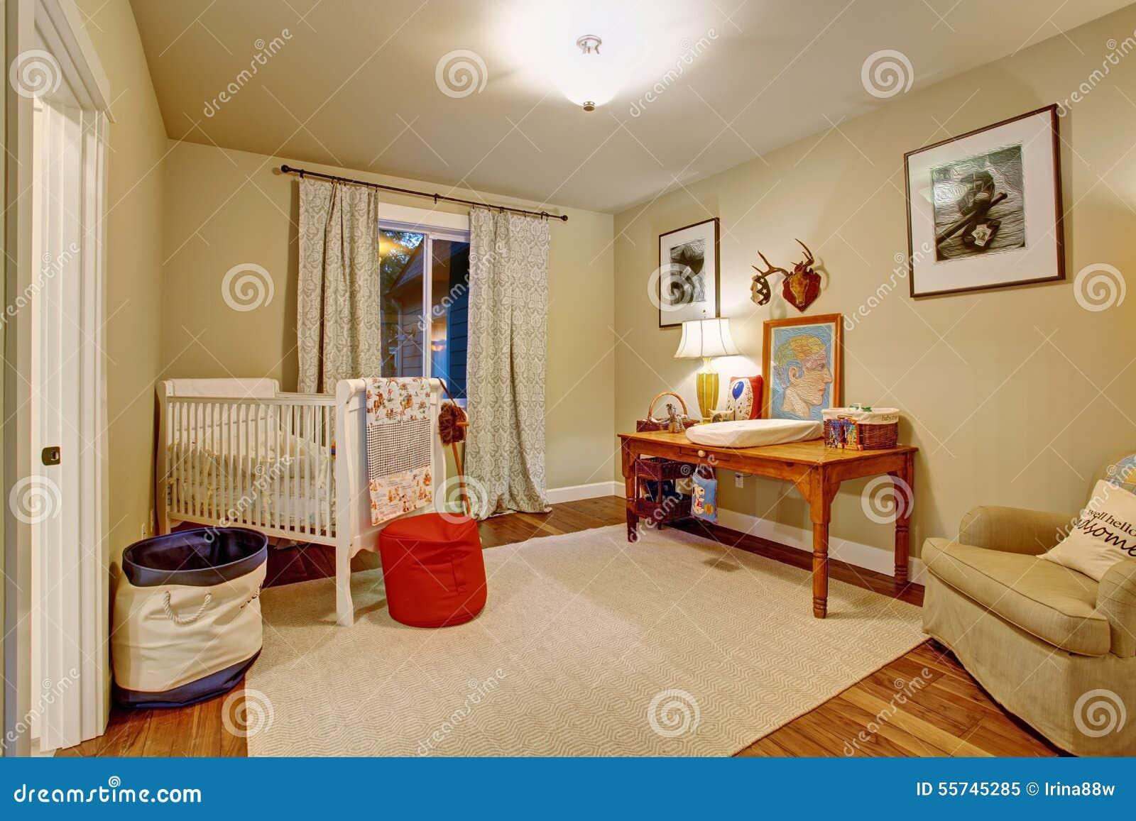Nice baby room with hardwood floor.