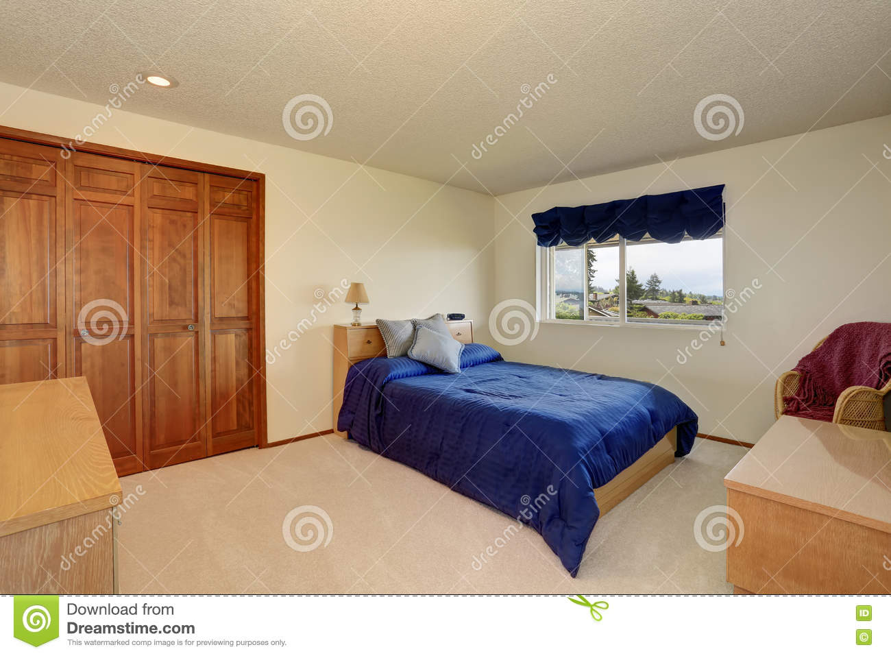 Download Nice Bedroom In Creamy Tones With Small Bed, Built In Wardrobe  Stock Photo