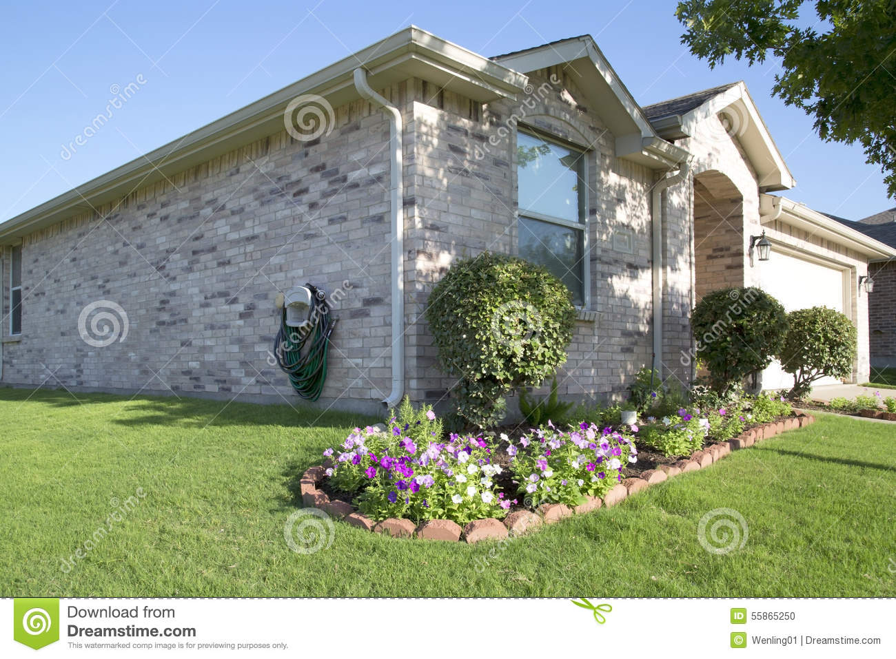 Nice brick house with garden in countryside stock photo for Nice home photos