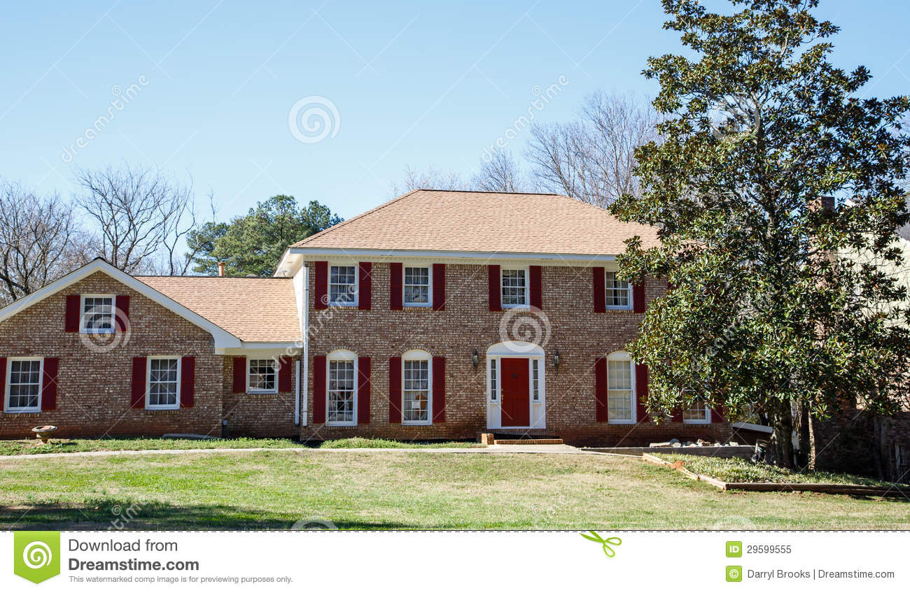 Nice Brick Two Story With Red Door Royalty Free Stock