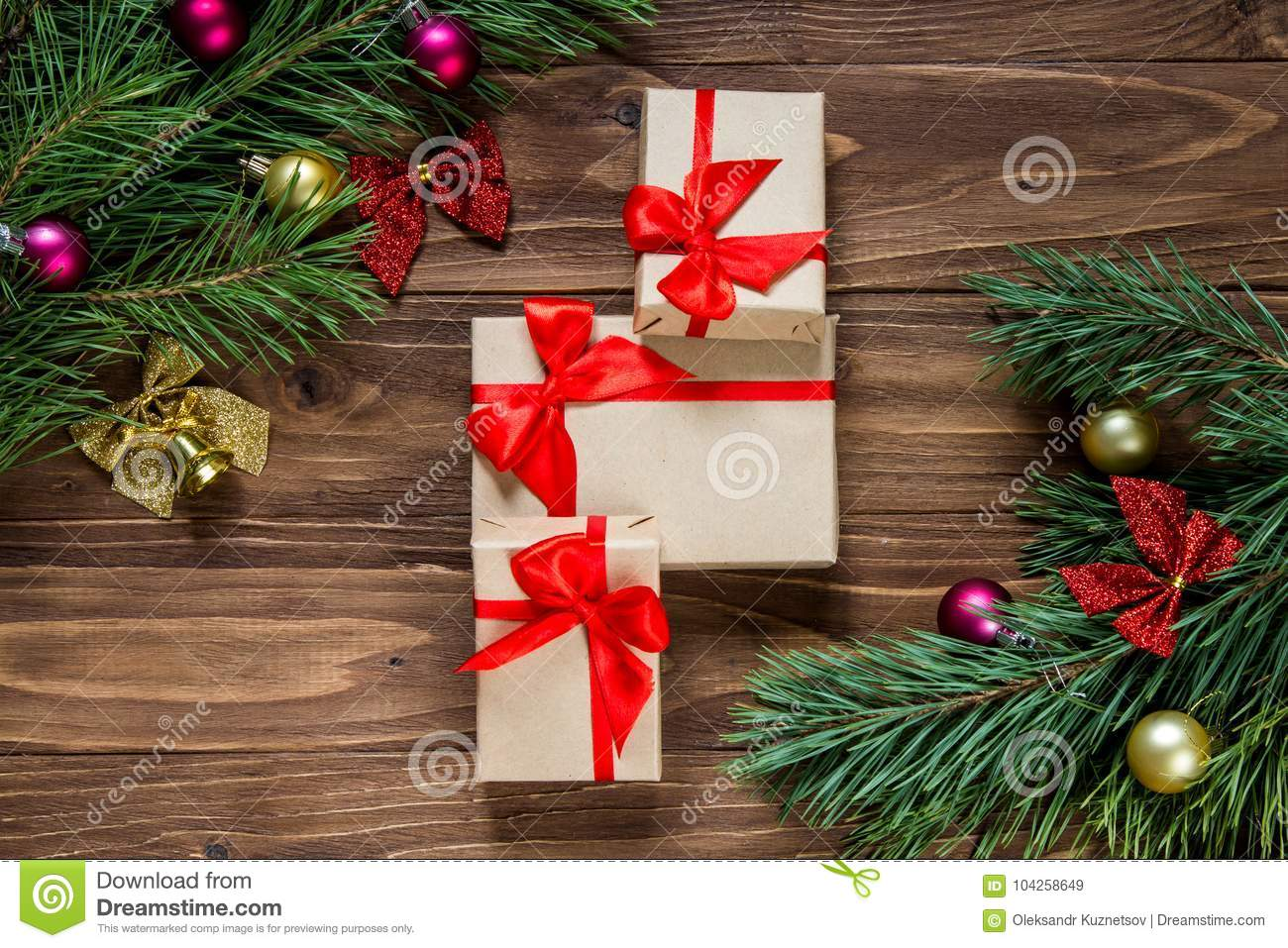 download nice christmas gifts exposition with pine tree tinsel in the middle of the wooden background - Nice Christmas Gifts