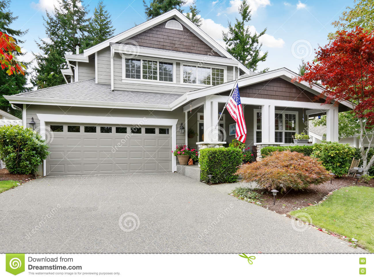 Nice curb appeal of grey house with covered porch and for American garage builders