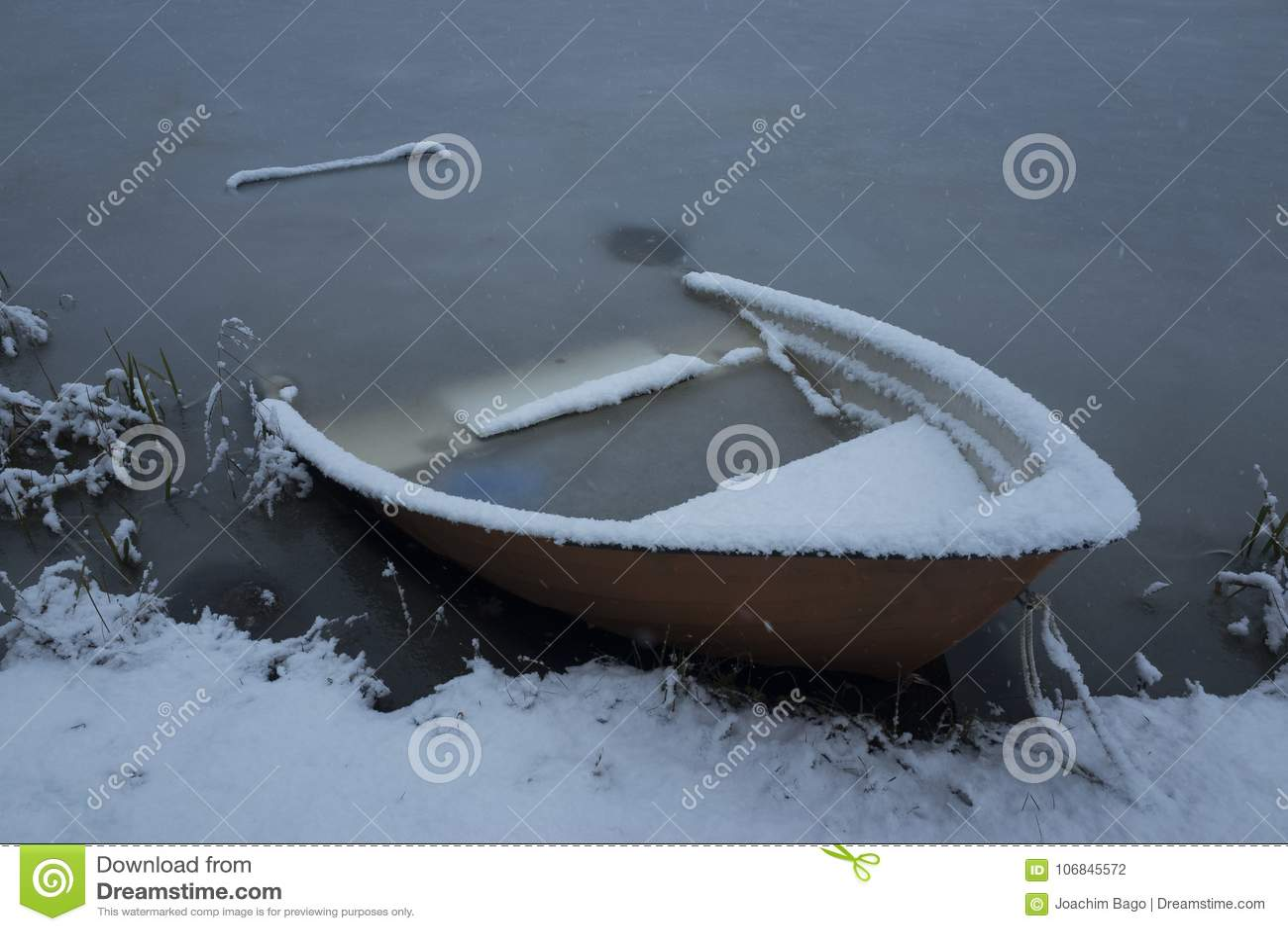 Nice details photo of frosty snowy boat frozen in lake in Sweden Scandinavia at winter
