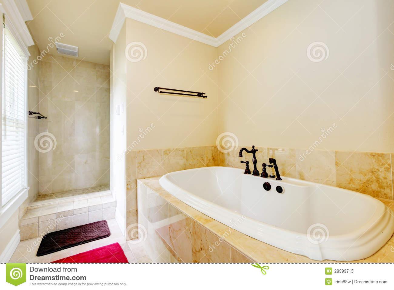 Nice Empty Bathroom With Large White Tub And Shower