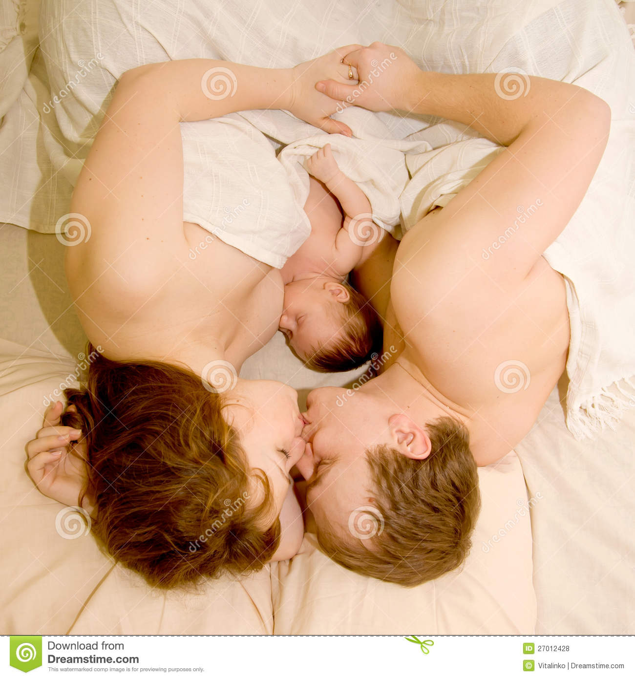 Nice family sleeping together in a white bed. Mother, father and ...: www.dreamstime.com/royalty-free-stock-photos-nice-family-sleeping...