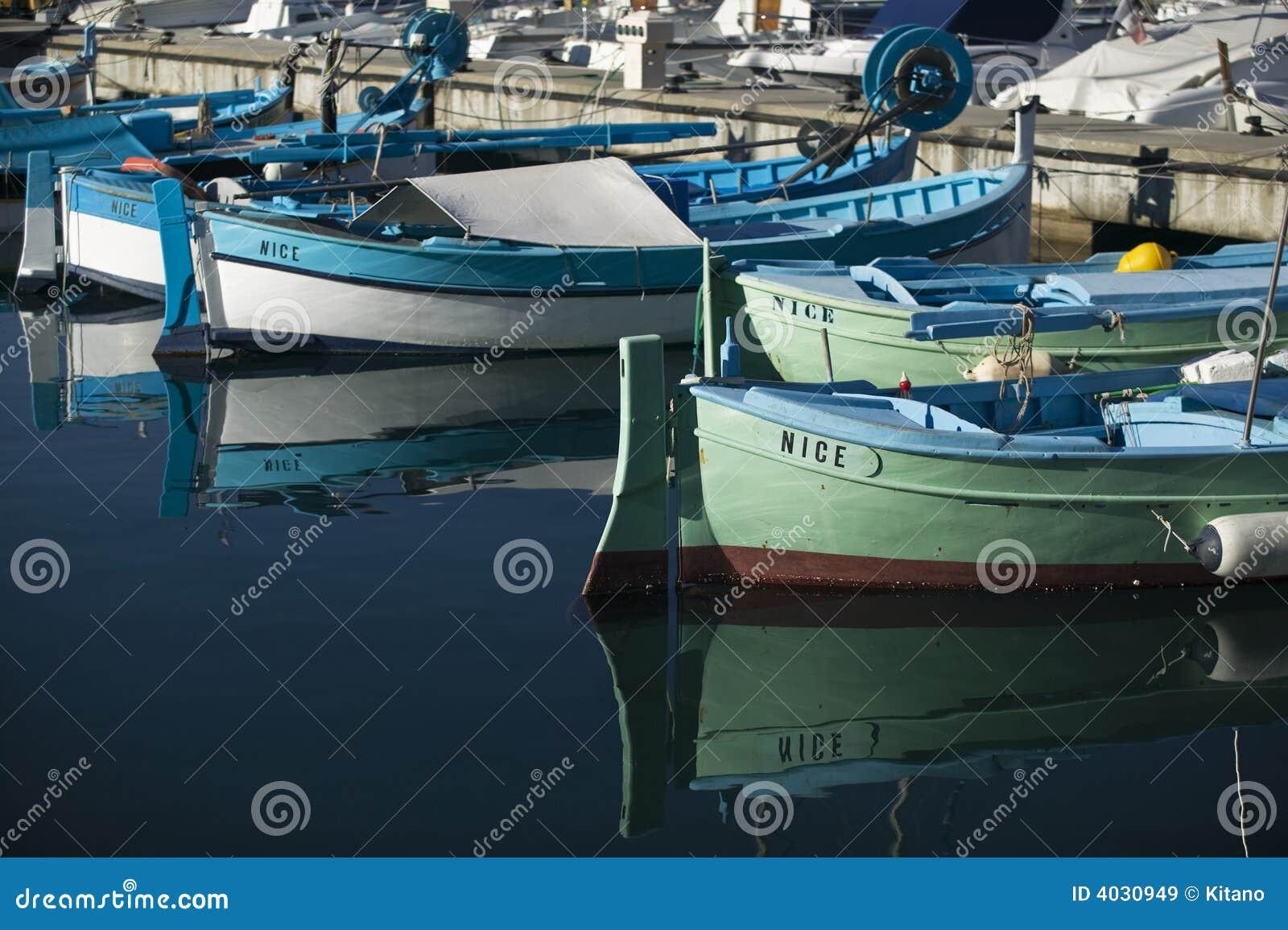 Nice fishing boats at harbor royalty free stock images for Nice fishing boats