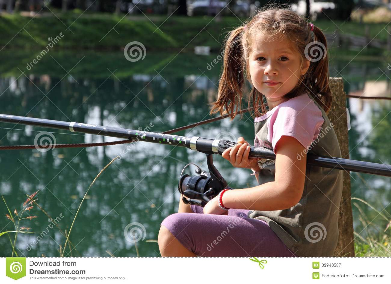 Nice girl with the fishing rod on the shores of lake for Little girl fishing pole