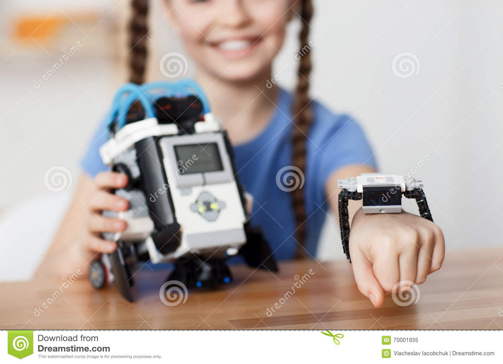 Nice girl playing with robot