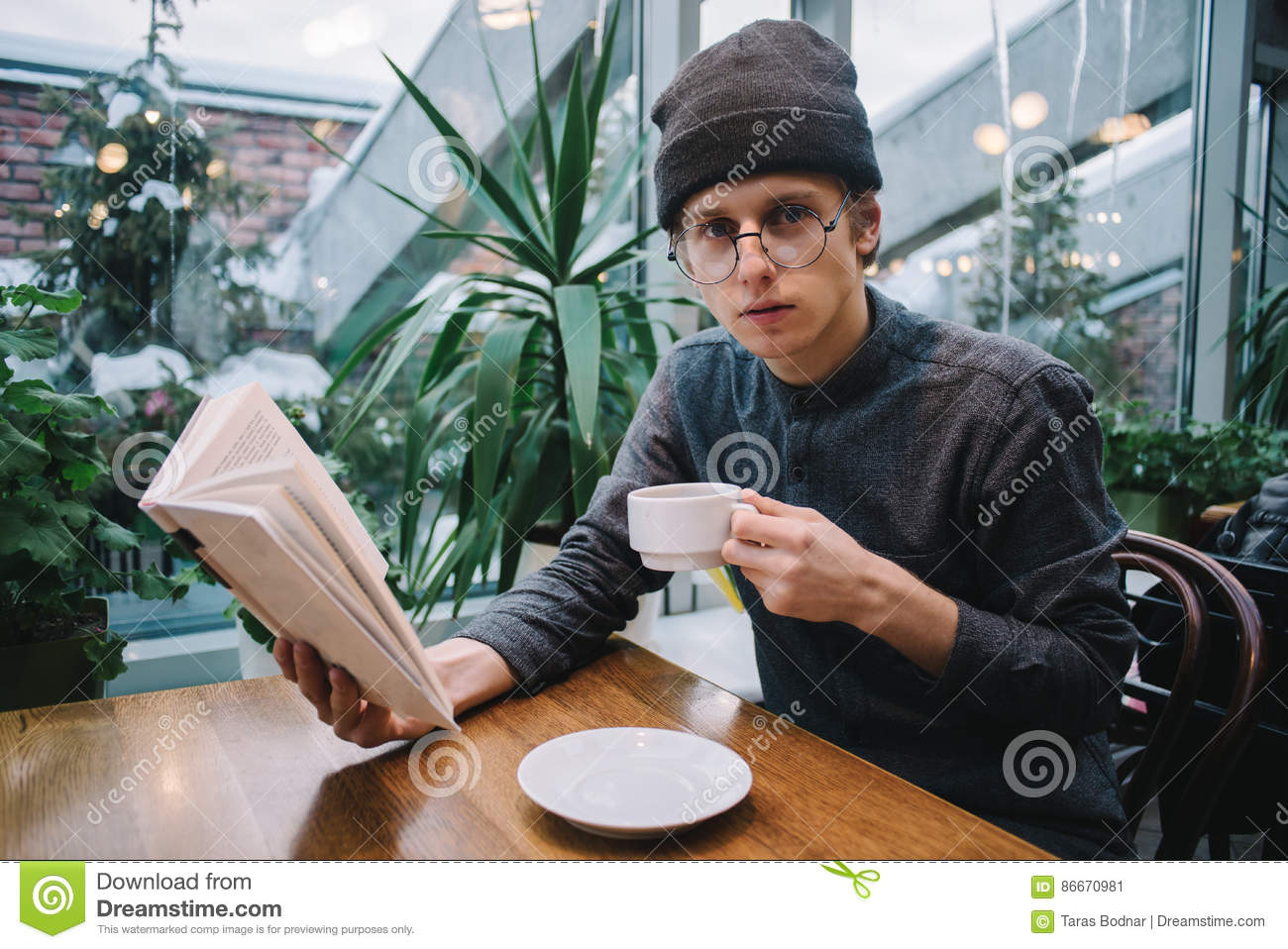 Nice Guy Hipster Glasses And Hat Reading A Book And ...