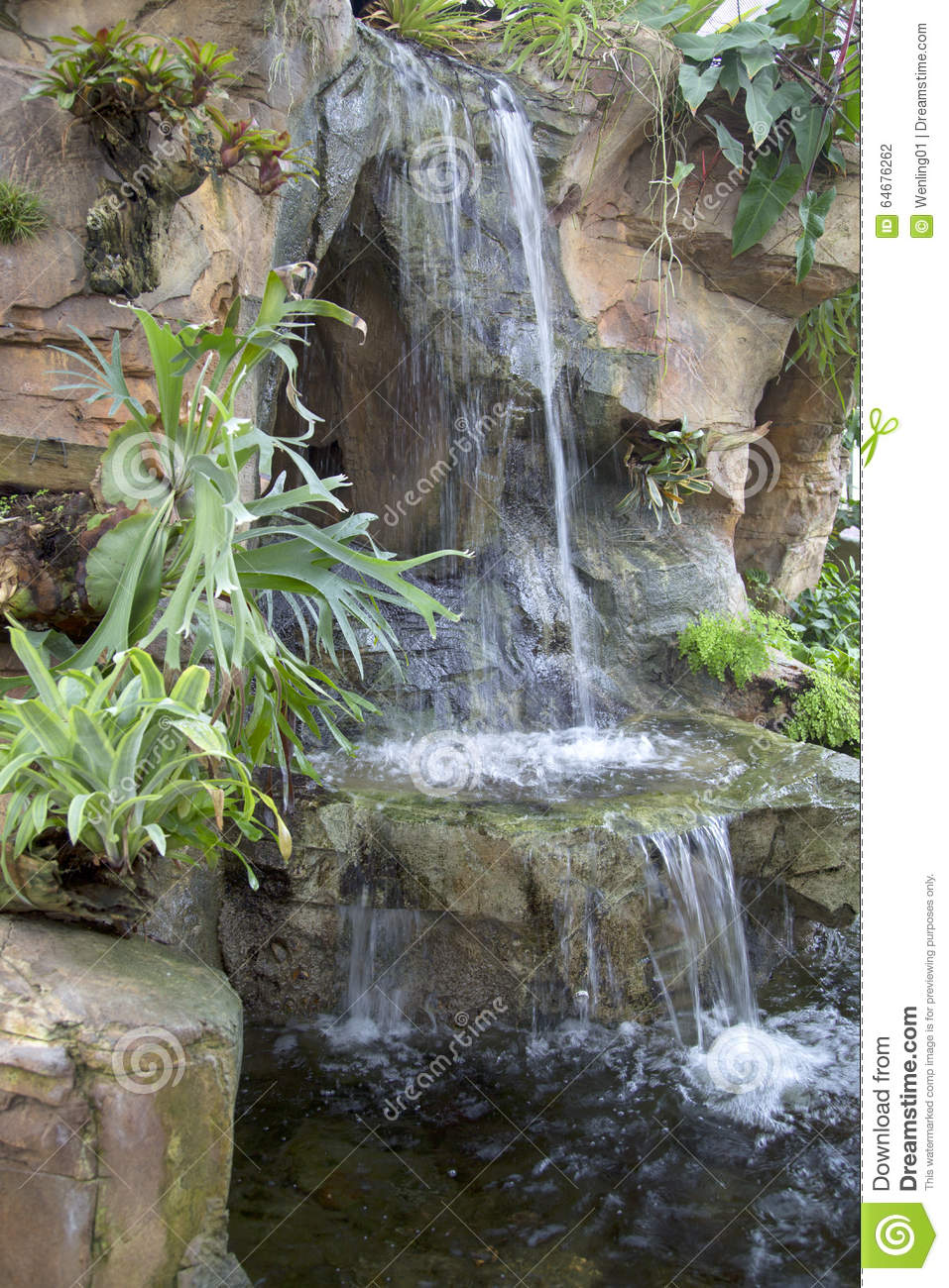 Nice indoor garden with waterfall design stock photo for Backyard waterfall design some hints