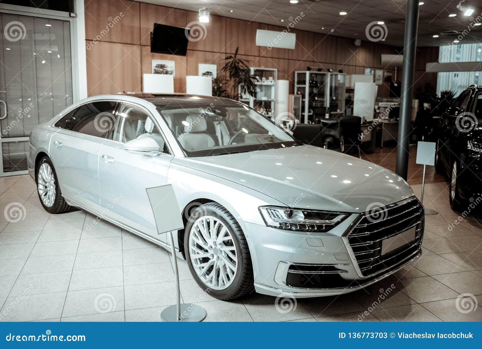 Nice light silver passenger car standing in car dealers