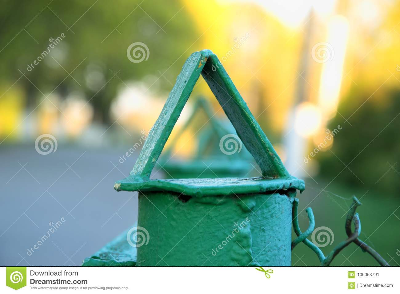 Nice macro photo of tops of the fence, triangle in the triangle,