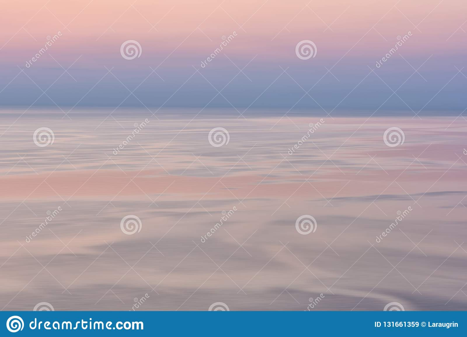 Nice pink sunset seascape in pastel shades, peace and calm outdoor travel background, motion blur