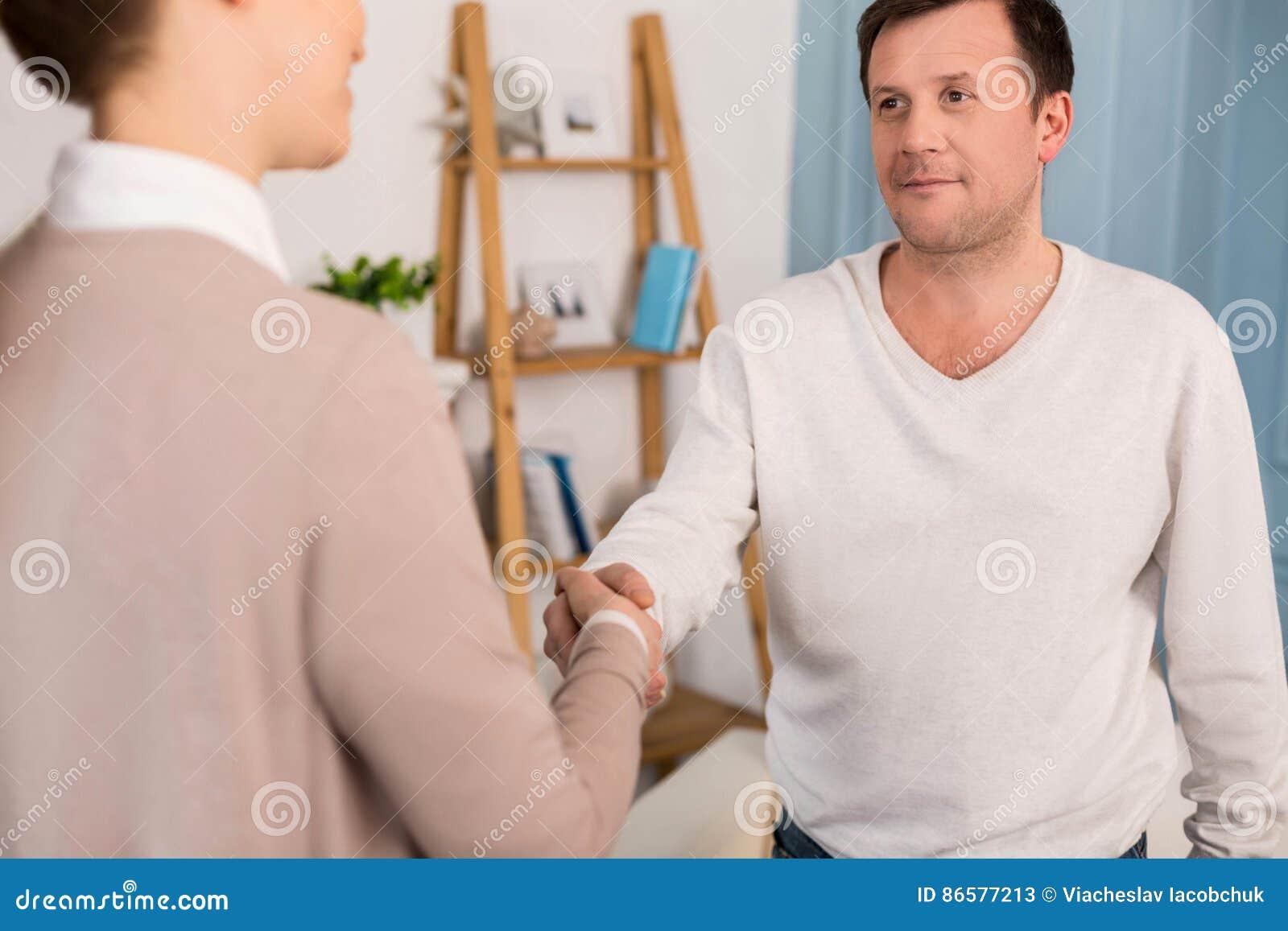 Nice pleasant man greeting a woman stock image image of nice pleasant man greeting a woman m4hsunfo