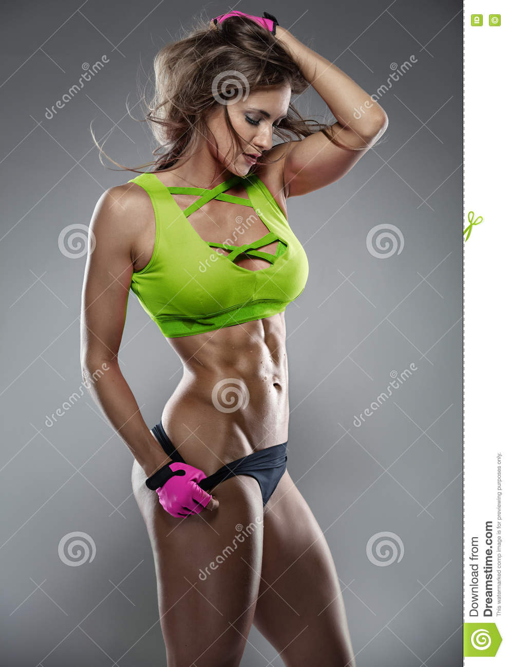 Nice fitness woman showing abdominal muscles