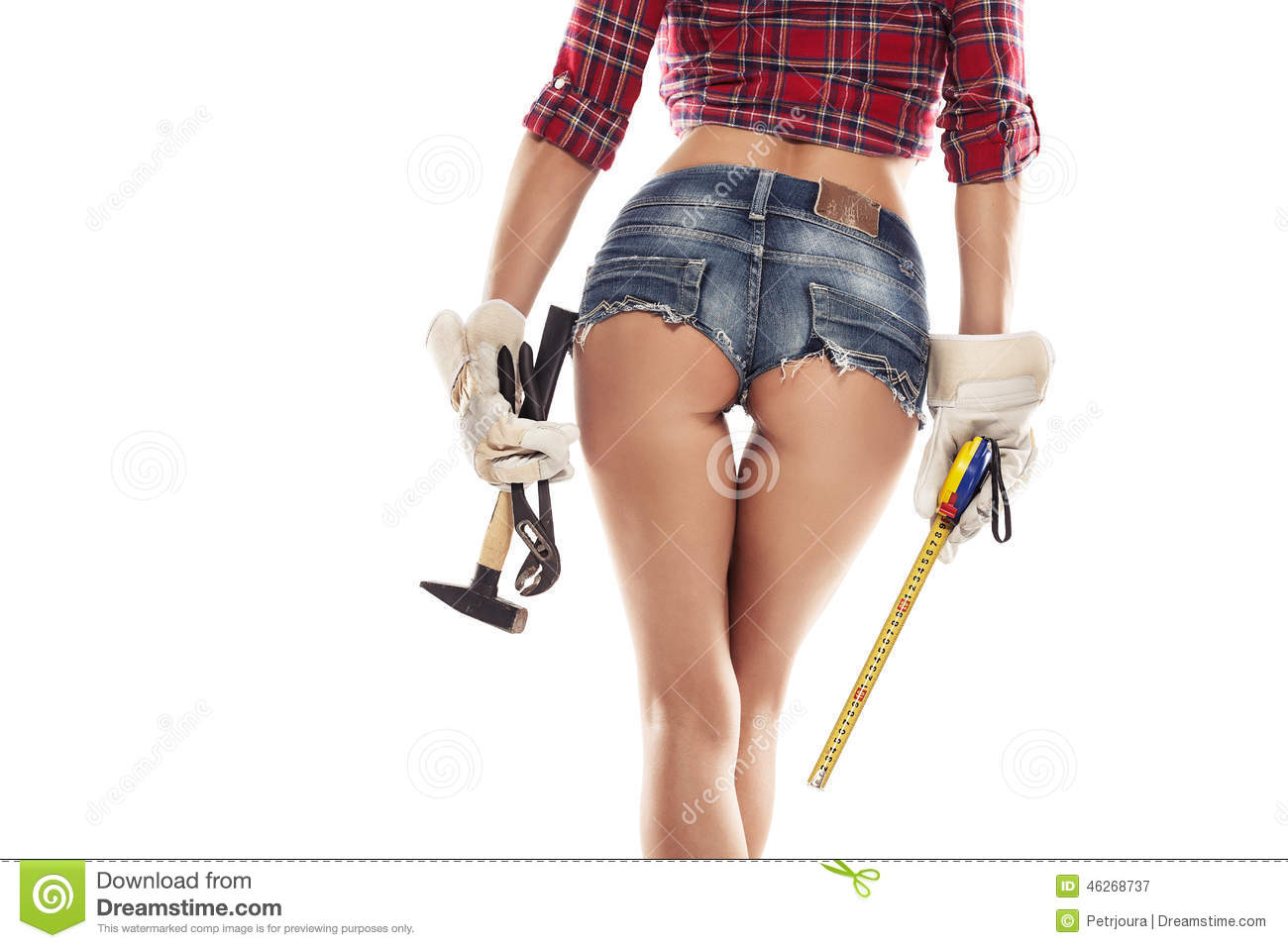 Nice woman mechanic showing buttock and holding hamme