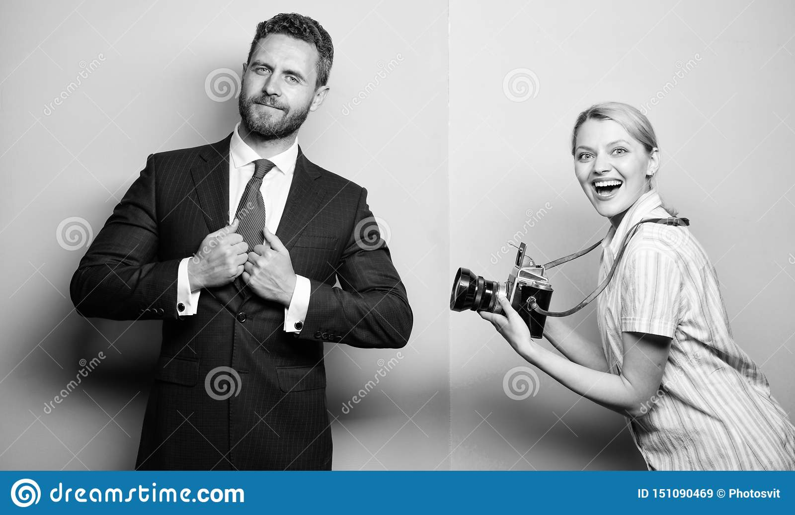 Nice shot. Fame and success. Businessman enjoy star moment. Photographer taking photo successful businessman. Paparazzi