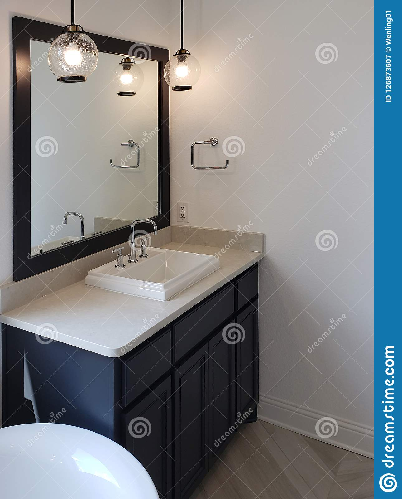 Cabinet D Architecte Nice sink and mirror of bathroom in a new house stock image