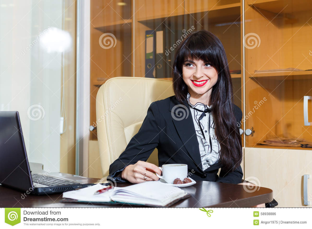 nice smiling woman in office drinking coffee person