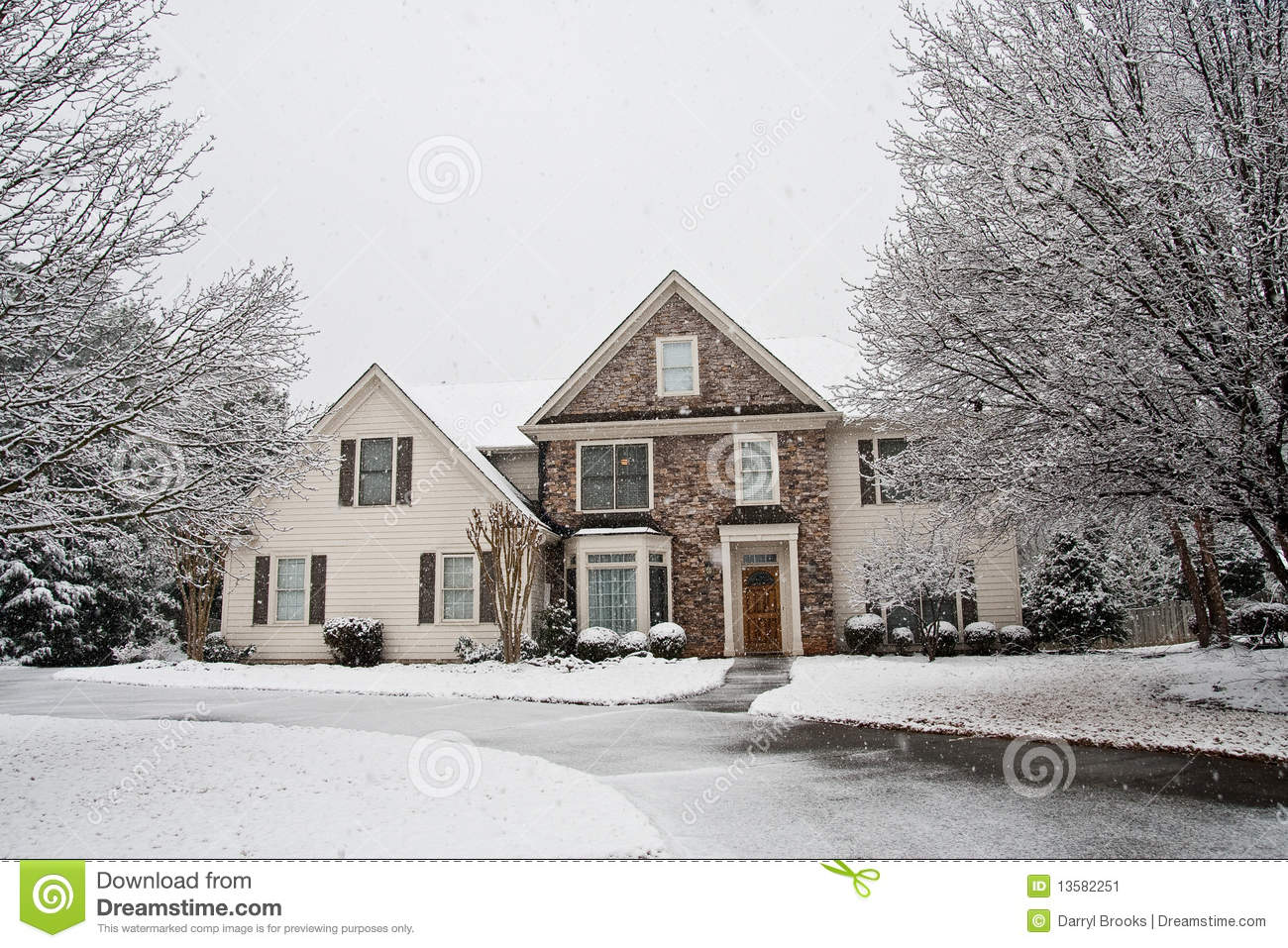Nice stone faced house in snow stock image image 13582251 for Stone faced houses