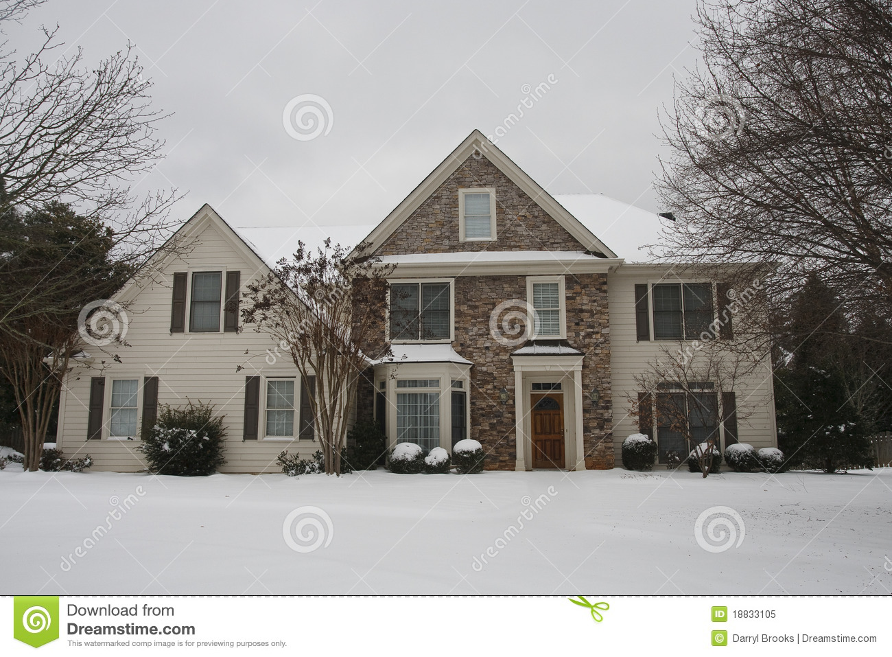Nice Stone And Siding House In Snow Royalty Free Stock