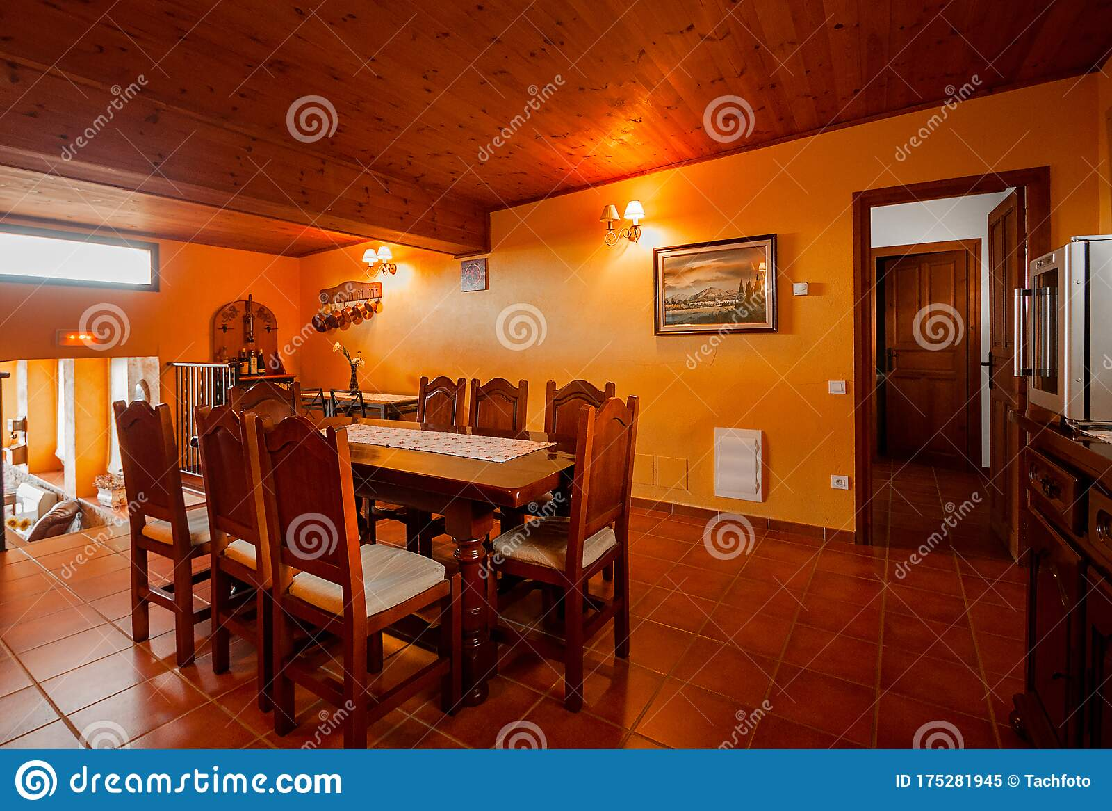 Nice Warm Interior Of Dining Room With Large Wooden Table And Chairs In A Rustic Style Country House Or Hotel Wooden Beams And Stock Image Image Of Design Living 175281945