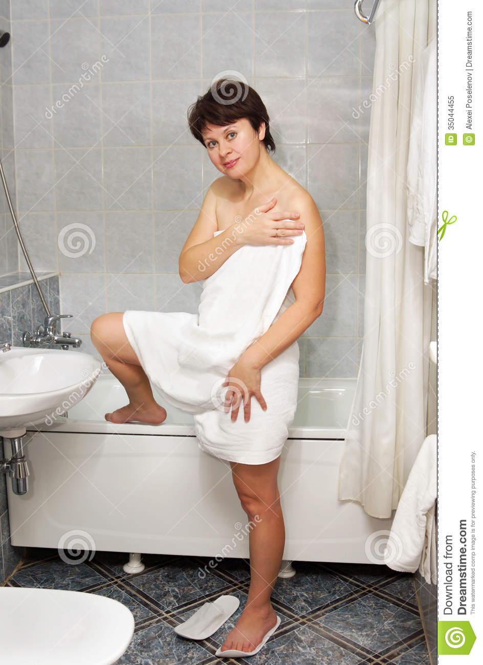 Nice Woman Steps Out From A Bath Into Bathroom Stock Image Image 35044455