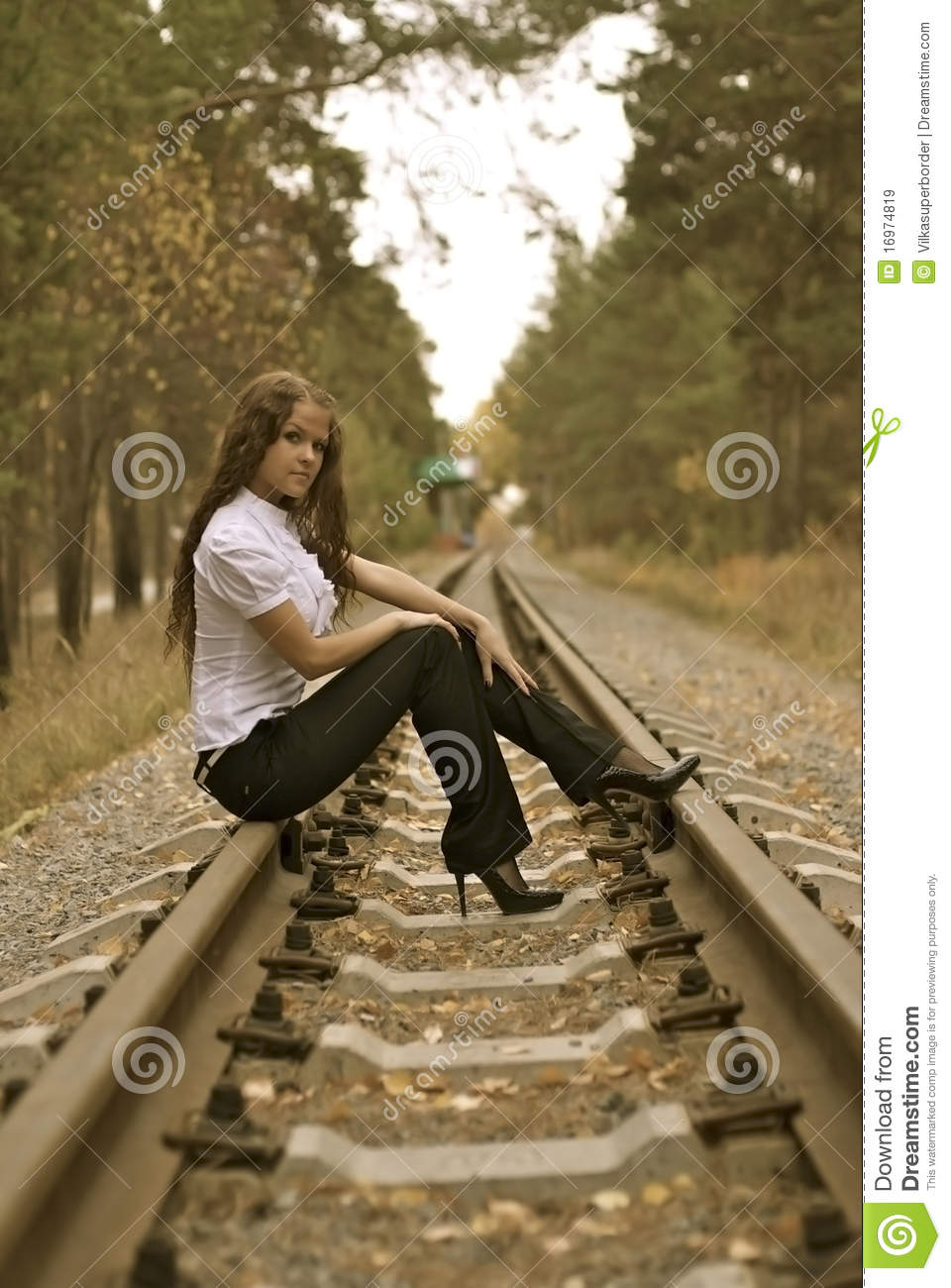 nice young girl on a railroad royalty free stock images